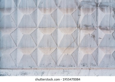 Geometric texture of gray concrete fence with square elements. Square patter. Border. Grey. Area. Huge. Background. Protect. Protection. Dirty. White