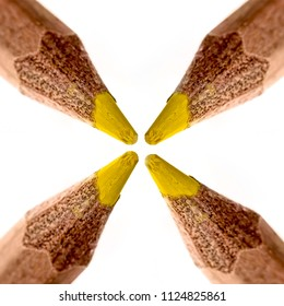Geometrical square collage of a yellow pencil tip against a white background - macro shot.