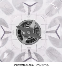 Geometry inside blender plastic collector recipient with stainless steel sharp blades knive in the center