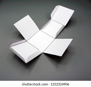 Geometry net of  cube. 2-dimensional shape that can be folded to form a 3-dimensional shape or a solid. Unfolded three Dimensional Figures. Isolated.