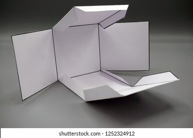 Geometry net of rectangular prism cube . 2-dimensional shape that can be folded to form a 3-dimensional shape or a solid. Unfolded three Dimensional Figures. Isolated.