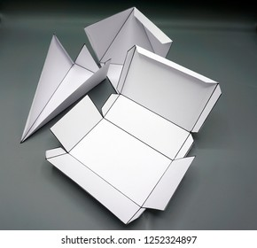 Geometry net of rectangular prism/ pyramid/ cube/ . 2-dimensional shape that can be folded to form a 3-dimensional shape or a solid. Unfolded three Dimensional Figures. Isolated.