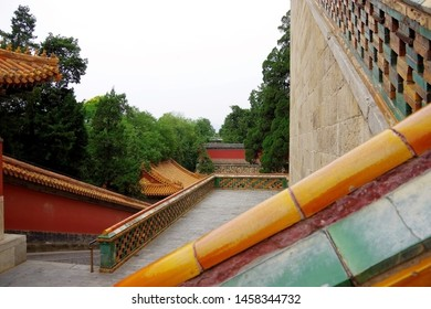 Geometry in the old Asian Buddhist temple. Stone walls, wood roofs and green trees.