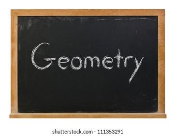 Geometry written in white chalk on a black chalkboard