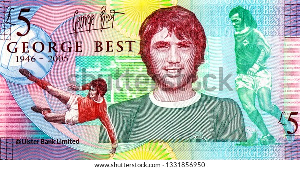 George Best, a legendary left-wing player in Northern Ireland Of Manchester United. portrait from Ireland money 2006 on 5 Pounds The memorial of  Northern Ireland banknote. Closeup Collection.