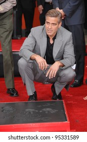 """George Clooney at hand & footprint ceremony at Grauman's Chinese Theatre for the stars of """"Ocean's Thirteen."""" June 5, 2007  Los Angeles, CA Picture: Paul Smith / Featureflash"""
