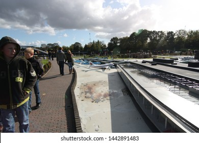 George Maduroplein, The Hague, The Netherlands, October 17, 2009 People look at the miniature of Amsterdam Airport Schiphol of 1:25 scale model replicas in Madurodam park open air museum Den Haag.