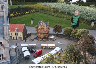 George Maduroplein, The Hague, The Netherlands, October 17, 2009. A young boy is looking at the replica of a Netherlands village in Madurodam Park that has been built at a scale of 1:25