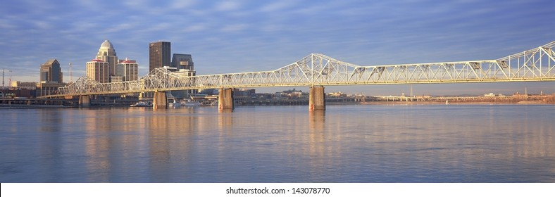 George Rogers Clark Memorial Bridge over the Ohio River with Louisville skyline in the background, KY
