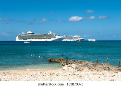GEORGE TOWN, CAYMAN ISLANDS - NOVEMBER 3: Cruise ships anchored at the harbor of Grand Cayman for this popular stop of cruise lines on nov 3, 2011 in George Town, Cayman Islands.
