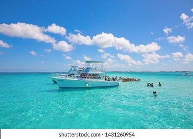 GEORGE TOWN - February 16: Unidentified people visiting Stingray city on Gran Cayman on February 16, 2019 in George town, Cayman islands. Stigray city is famous snokerling spot visited on cruise.