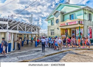George Town, Grand Cayman, Cayman Islands, Feb 2018, tourists by the port North terminal queuing to re-embark on their cruise ship
