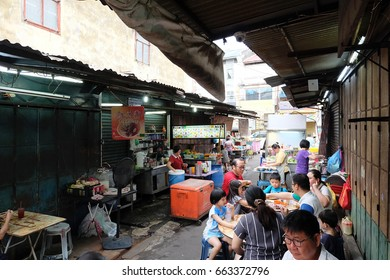 George Town, Malaysia - 4 June ,2017 : People eating street food on the alley in the famous chulia food street in George Town, Penang on 4 June 2017 in George Town, Malaysia