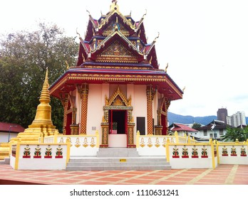GEORGE TOWN, MALAYSIA - December 10, 2013: decorated, small shrine in the garden of famous Wat Chaiyamangalaram Thai buddhist temple