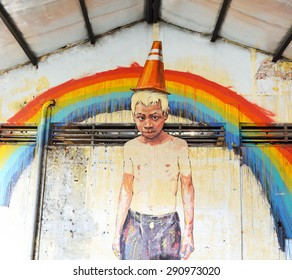 GEORGE TOWN, MALAYSIA- JUNE 6, 2015:The boy on the wall, Painted wall mural at Hinbus Depot Gallery by artist Ernest Zacharevic in George town, Penang, Malaysia.
