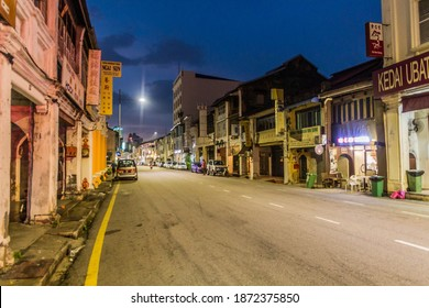 GEORGE TOWN, MALAYSIA - MARCH 20, 2018: Evening view of a street in George Town, Malaysia