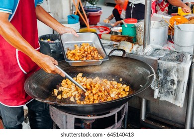 GEORGE TOWN, MALAYSIA - MARCH 23: Man cooks food at Kimberly Street Food Night Market on March 23, 2016 in George Town, Malaysia.