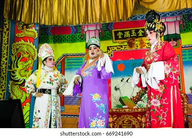 GEORGE TOWN, MALAYSIA - MARCH 26: Actors plays Traditional Chinese Opera on the street scene on March 26, 2016 in George Town, Malaysia.