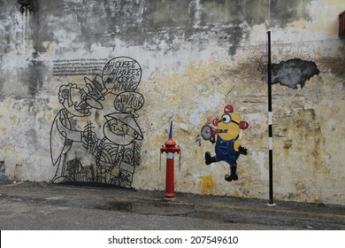 GEORGE TOWN, MALAYSIA - MAY 30: One of the many artworks on the wall of a building in Georgetown, Malaysia on the 30th May, 2014.
