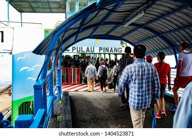 George Town Penang Island, Malaysia - May 12, 2019 : Boarding the ferry at Raja Tun Uda ferry terminal to Butterworth, penang mainland from  Penang island.