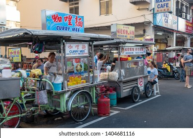 George Town Penang Island, Malaysia - May 12, 2019 : New lane street penang island is one of the top 5 destination for local street food. Tricycle mobile food stall is very common in penang island.