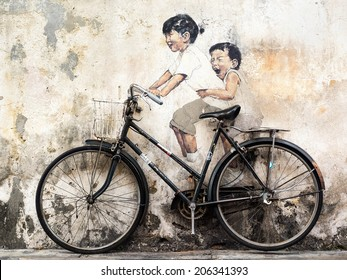 "George Town, Penang, Malaysia - April 23: ""Little Children on a Bicycle"" street art mural by Lithuanian artist Ernest Zacharevic in Georgetown, Penang, Malaysia."