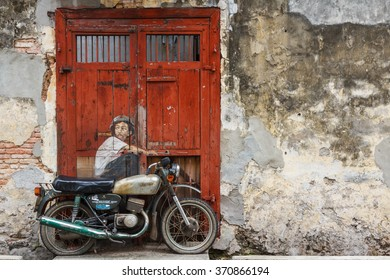 GEORGE TOWN (PENANG) / MALAYSIA - CIRCA JANUARY 2013: One of the famous murals on the walls of the old town of George Town in Malaysia