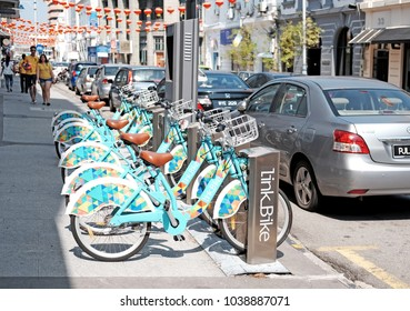 GEORGE TOWN, PENANG, MALAYSIA - FEB 10, 2018: LinkBike bike sharing bicycle in Beach Street, Penang. The bike sharing facilities launched in 2016 is the first in Malaysia.