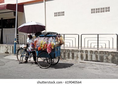 GEORGE TOWN, PENANG, MALAYSIA - FEB 12, 2010: A traditional vintage bread vendor trishaw in Lebuh Chulia, Penang. Penang traditional lifestyle is part of the UNESCO world heritage.