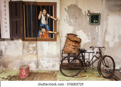 """George Town, Penang, Malaysia - February 11, 2016: Wall artwork called """"Brother and Sister"""" street art in George Town, Penang"""