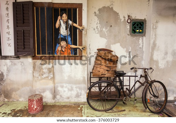 "George Town, Penang, Malaysia - February 11, 2016: Wall artwork called ""Brother and Sister"" street art in George Town, Penang"