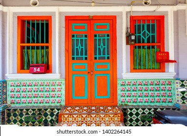 George Town, Penang, Malaysia - January 15 2019: Peranakan typical style windows and ornate entrance doors an floor tiles