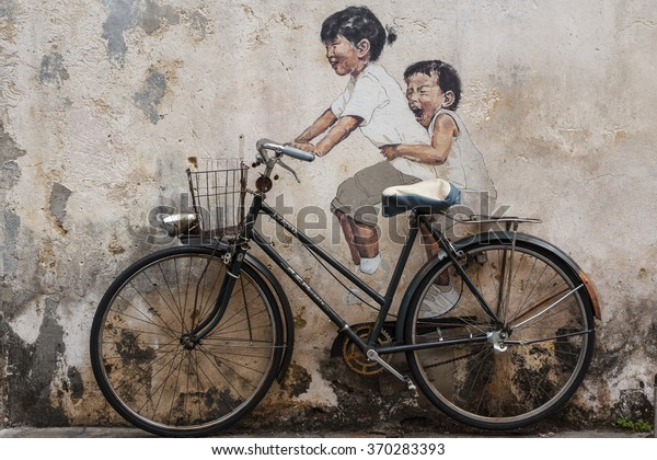 GEORGE TOWN (PENANG) / MALAYSIA - JANUARY 2013: One of the famous murals on the walls of the old town of George Town in Malaysia