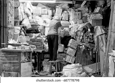 GEORGE TOWN, PENANG, MALAYSIA - JUL 24, 2017: An old storekeeper at her storage in Chowrasta market in Jalan Chowrasta. Penang traditional lifestyle is part of the UNESCO world heritage.
