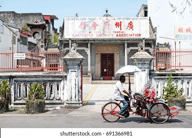 GEORGE TOWN, PENANG, MALAYSIA - JUL 26, 2017: Facade of the Cantonese District Association in Ng Fook Thong Temple in Lebuh Chulia, George Town. The area is part of the UNESCO World Heritage Site.