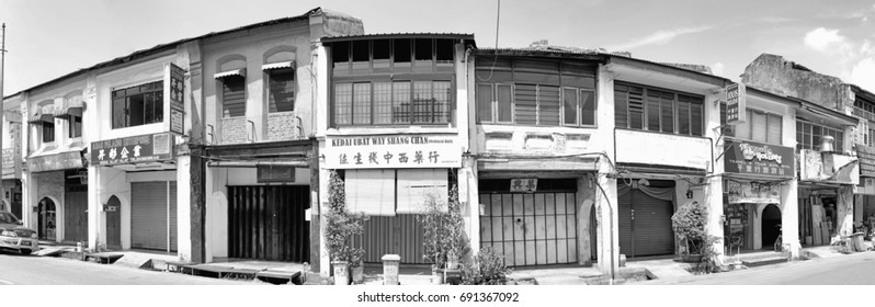 GEORGE TOWN, PENANG, MALAYSIA - JUL 26, 2017: Panoramic view of vintage shop houses in Lebuh Chulia, George Town, Penang. The area is part of the UNESCO World Heritage Site.