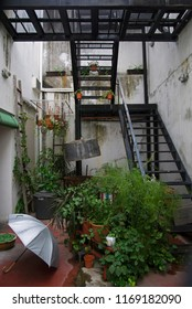 george town, penang/malaysia - february 23, 2017: idyllic garden backyard / patio of a cafe on lebuh penang with stairs