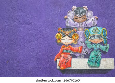 GEORGE TOWN,PENANG ,MALAYSIA- CIRCA March 26, 2015: Public street art Name Three chinese dolls on the wall  with black and white color in Georgetown, Penang, Malaysia.