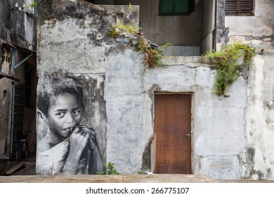 GEORGE TOWN,PENANG ,MALAYSIA- CIRCA March 26, 2015: Public street Black and White boy painting Street Art by Julia Volchkova with realistic mood ,Graffiti in George Town, Malaysia