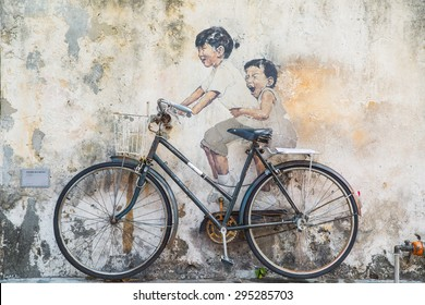 GEORGE TOWN,PENANG ,MALAYSIA- CIRCA March 26, 2015: Public street art Name Children on a bicycle painted 3D on the wall that's two little  Chinese girls riding bicycle in Georgetown, Penang, Malaysia.