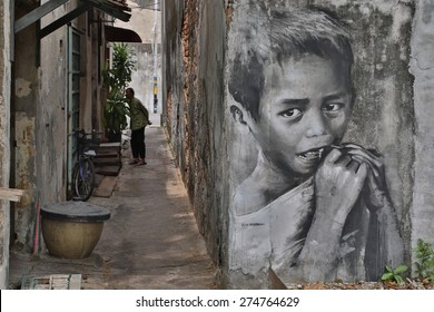 GEORGE TOWN,PENANG ,MALAYSIA- March 26, 2015: Public street Black and White boy painting Street Art by Julia Volchkova with realistic mood ,Graffiti in George Town, Malaysia