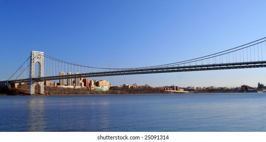 The George Washington Bridge crosses over the Hudson River from New Jersey to The Bronx, New York