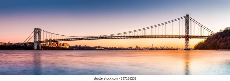 George Washington Bridge panorama above the New York skyline, at sunset