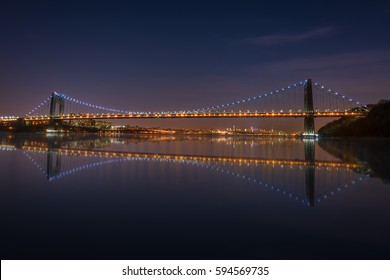 The George Washington Bridge spanning the Hudson River at night in New York City.