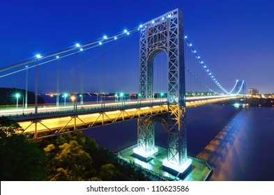 The George Washington Bridge spans the Hudson River from Fort Lee, New Jersey to the Washington Heights neighborhood in the borough of Manhattan in the city of New York, New York.