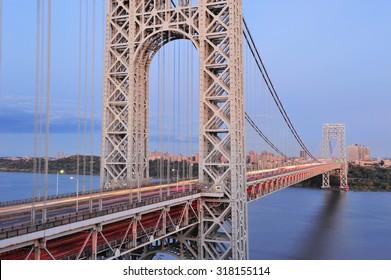 George Washington Bridge at sunset over Hudson River.