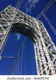 George Washington Bridge - view from below on metal pillars  and suspension cables