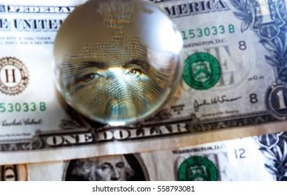 George Washington closeup eye under cristal globe  on the one dollar note