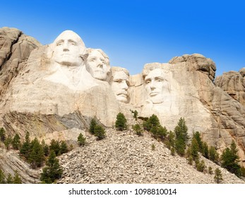 George Washington, Thomas Jefferson, Theodore Roosevelt and Abraham Lincoln and the flags of the States at Mt. Rushmore National Memorial, Keystone, South Dakota, US