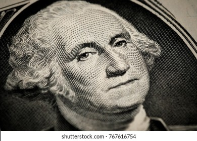 George Washington's portrait on one (1) american dollar bill. Macro close up view.